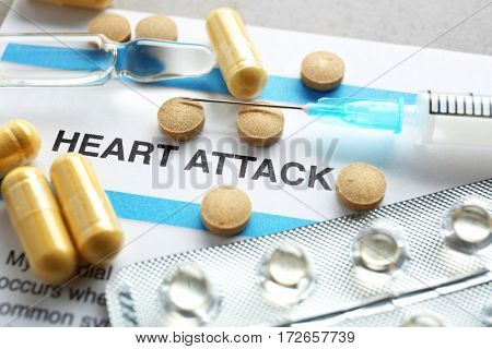 Diagnosis HEART ATTACK on medical report and medicines closeup