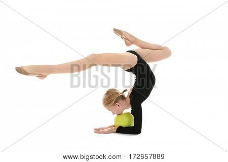 Young girl doing gymnastic exercise with ball, isolated on white