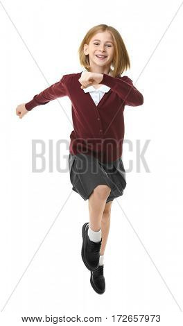 Cute girl in school uniform running on white background