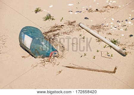 Polluted with trash sand shore