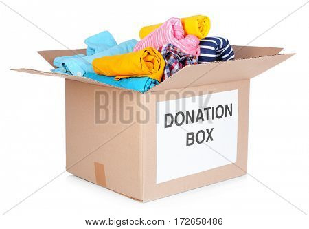 Donation box with clothes isolated on white