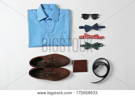 Flat lay set of male clothes and accessories on white background