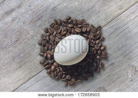 Coffee Beans And Easter Egg On Wooden Background