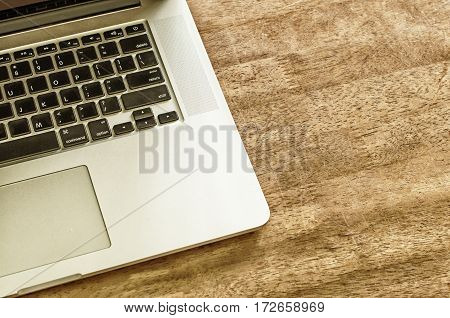 Vintage style tone .Table wood with notebook , View from above with copy space.
