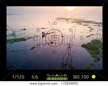 camera viewfinder detail with travel destination attraction.