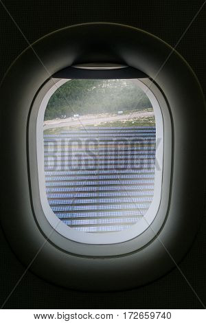 The Window Of Airplane With Solar Farm