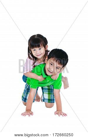 Asian kindly brother with his sister on piggyback ride and smiling happily isolated on white background. Concept about loving and bonding of sibling. Happy family spending time together. Studio shot.