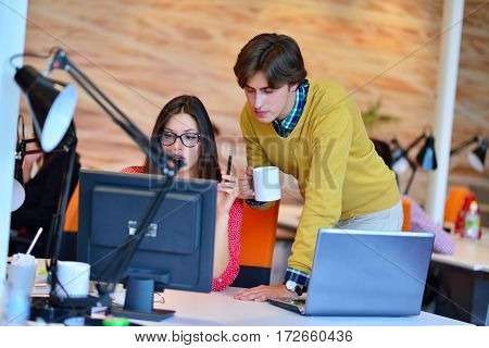 business couple working together on project at modern startup office.