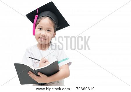 Happy Asian school kid graduate writing book with graduation cap isolated on white background