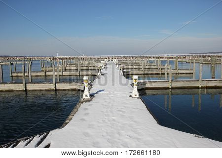 A snow covered dock in Traverse City, Michigan