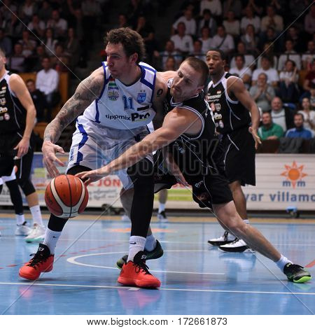 KAPOSVAR, HUNGARY - FEBRUARY 4: Roland Hendlein (white 11) in action at Hungarian Championship basketball game with Kaposvar (white) vs. Pecsi VSK (black) on February 4, 2017 in Kaposvar, Hungary.