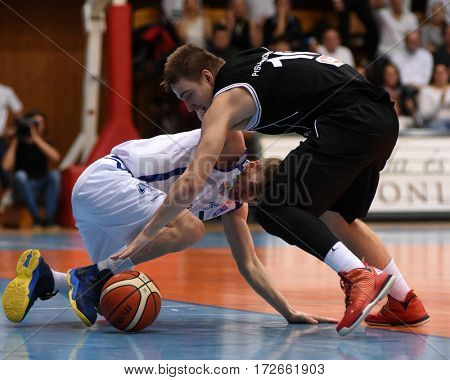 KAPOSVAR, HUNGARY - FEBRUARY 4: Peter Papp (in white) in action at Hungarian Championship basketball game with Kaposvar (white) vs. Pecsi VSK (black) on February 4, 2017 in Kaposvar, Hungary.