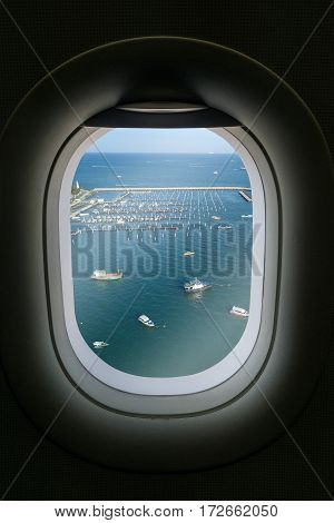 The window of airplane with Pattaya attraction.
