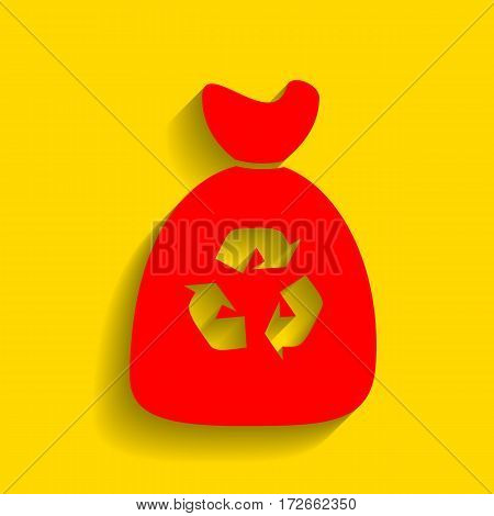 Trash bag icon. Vector. Red icon with soft shadow on golden background.