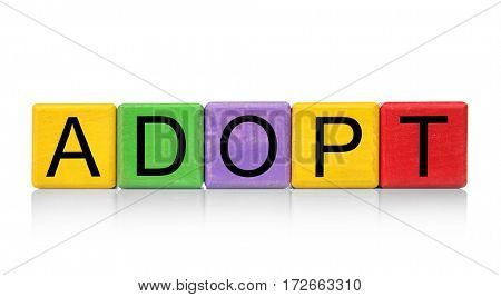 Colorful cubes with word ADOPT on white background