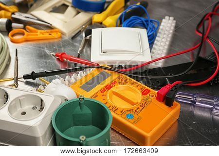 Electrician tools on metal background, closeup
