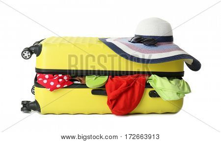 Traveler bag with clothes, isolated on white