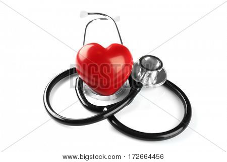 Stethoscope and red plastic heart isolated on white. Cardiology concept
