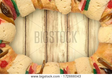 Epiphany cake Kings cake Rosca de reyes with wooden background