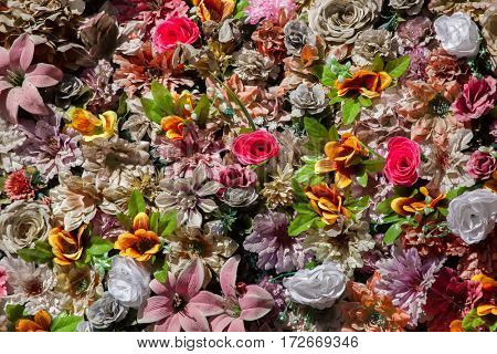 Plastic colourful flowers. Background texture.