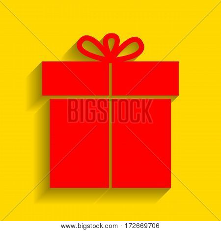 Gift sign. Vector. Red icon with soft shadow on golden background.