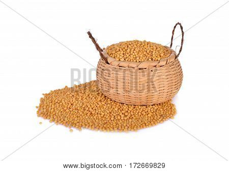 dried mustard seeds in bamboo basket and on white background