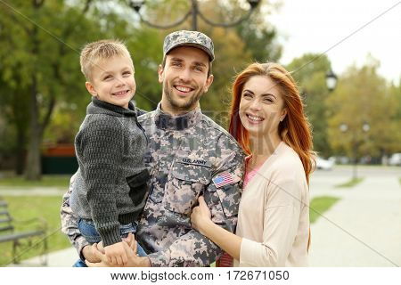 Soldier reunited with his family  in park