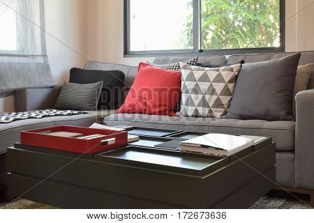 Modern Living Room Design With Red And Gray Pillows On Sofa