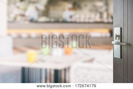Opened Wooden Door To Restaurant Interior With Colorful Tables Set For Meal