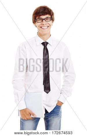 Portrait of young hispanic man wearing glasses, blue jeans, white shirt and black tie, holding book in his hand and smiling isolated on white background - students and education concept