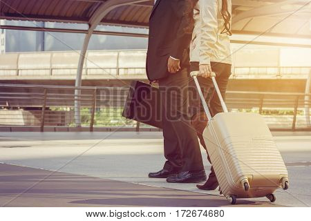 Businessman and businesswoman traveler with luggage at city background Business People Commuter Walking City Life Concept.