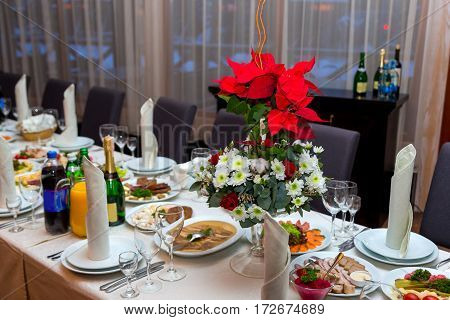 Red flower is on the banquet table. Corporate banquet