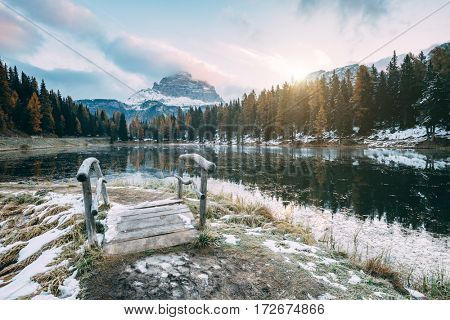 Great view of the foggy lake Antorno in National Park Tre Cime di Lavaredo. Location Auronzo, Misurina, Dolomiti alps, South Tyrol, Italy, Europe. Vintage style. Instagram toning effect. Beauty world.