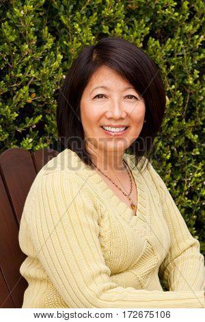 Portrait of a mature Asian woman smiling.