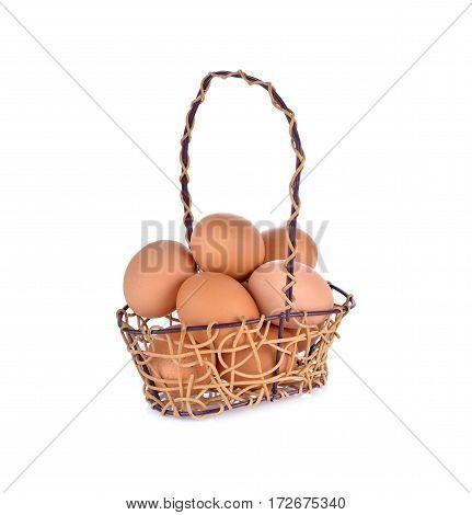 fresh eggs in rattan basket on white background
