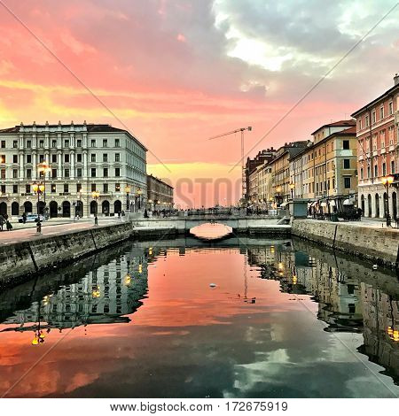 Awesome Sunset wide view of Ponterosso square in Trieste Italy.