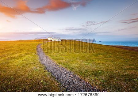 Fantastic views of the magical place on small peninsula. Popular tourist attraction. Dramatic and gorgeous scene. Location place Sudurland, cape Dyrholaey, coast of Iceland, Europe. Beauty world.