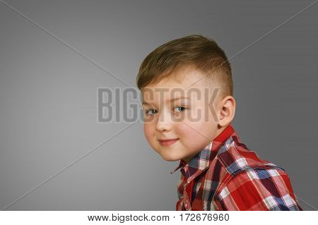 portrait of a beautiful boy . Stylish boy posing . the concept of children's fashion
