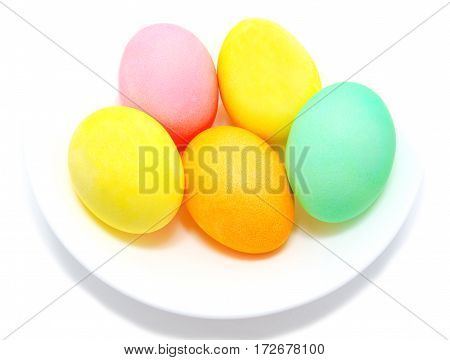Colorful easter eggs in bowl isolated on white background