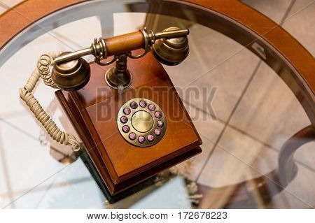 vintage telephone on glass table in hotel