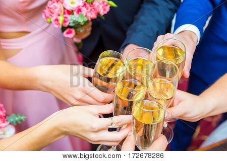 Photo of champagne glasses during toast at party
