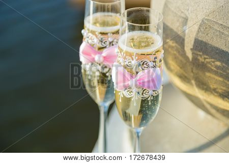 two glasses of champagne on the background of the lake