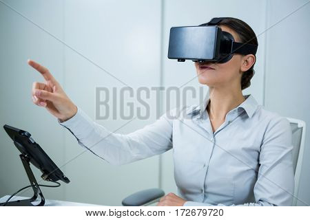Woman using virtual reality headset in optical store