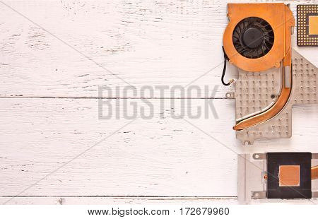 Cooling system of computer processor on white shabby wooden background.Heatpipe and radiatormicroprocessor. Top view.