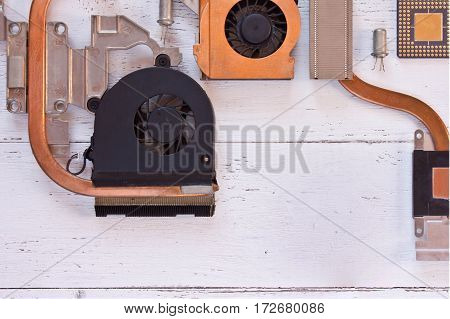 Close up view of cooling system of computer processor on white wooden background. Electronic board with heatpipe and radiatorsmicroprocessortransistors. Flat lay.