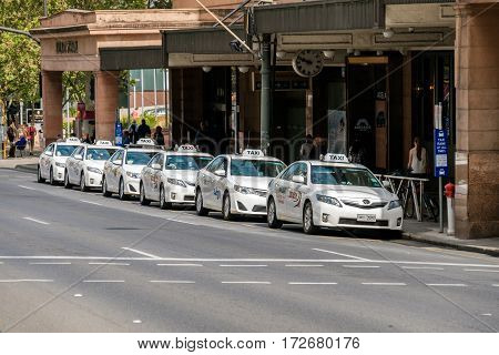 Adelaide Australia - November 11 2016: Taxi cars near Adelaide Railway Station viewed across the North Terrace on a day. Toyota Camry is the most popular model used as a taxi