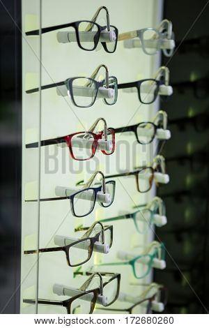 Various spectacles on display in optical store