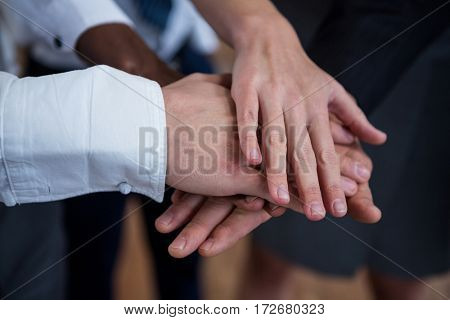 Close-up of business people with hand stack in office