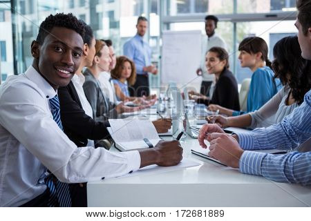 Businesspeople sitting at office desk working in office