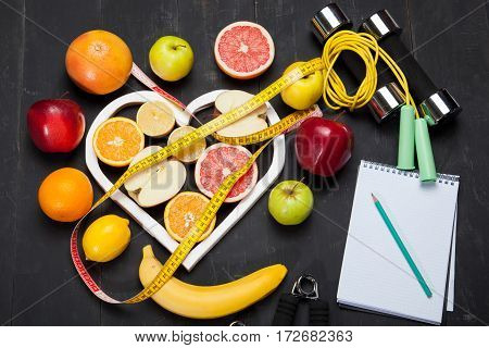 Sheet of Diet Plan and fresh products on wooden table top view